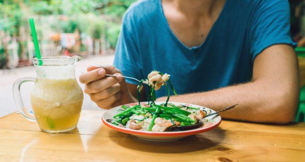 Man eating rice in cafe in Bangkok