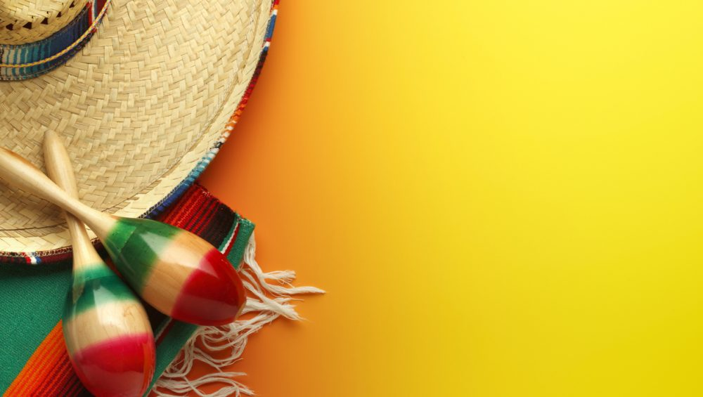 Cinco de Mayo Sombrero and Maracas On Yellow Background