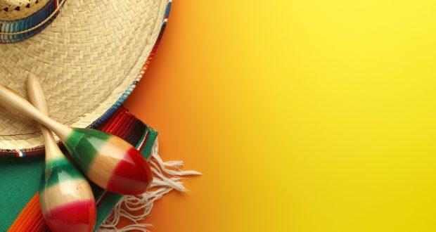 Cinco de Mayo Sombrero and Maracas On Yellow Background