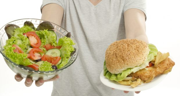 Man hands offering you salad and a hamburger